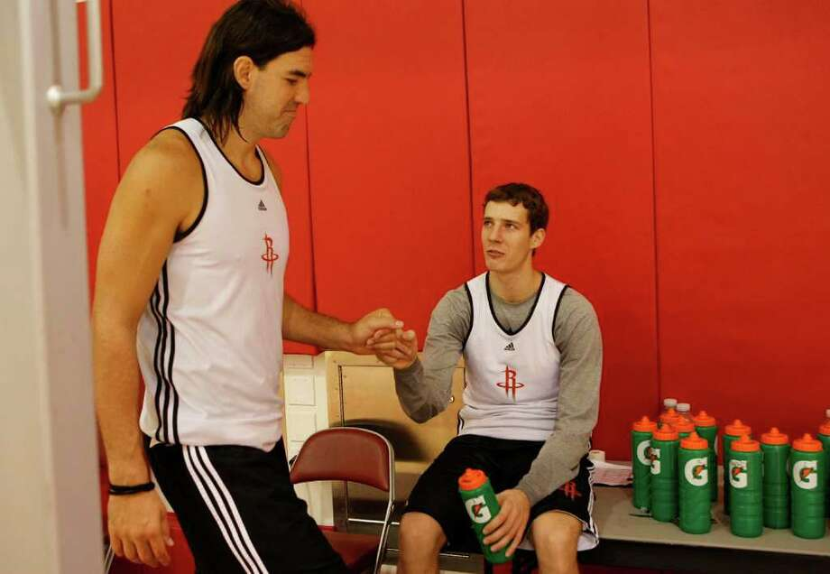 IT'S STRICTLY BUSINESS: Luis Scola, left, and Goran Dragic might have an easier time dealing with the voided trade because they have experience playing for teams in a variety of countries, according to former Rocket Matt Bullard. Photo: Johnny Hanson / © 2011 Houston Chronicle