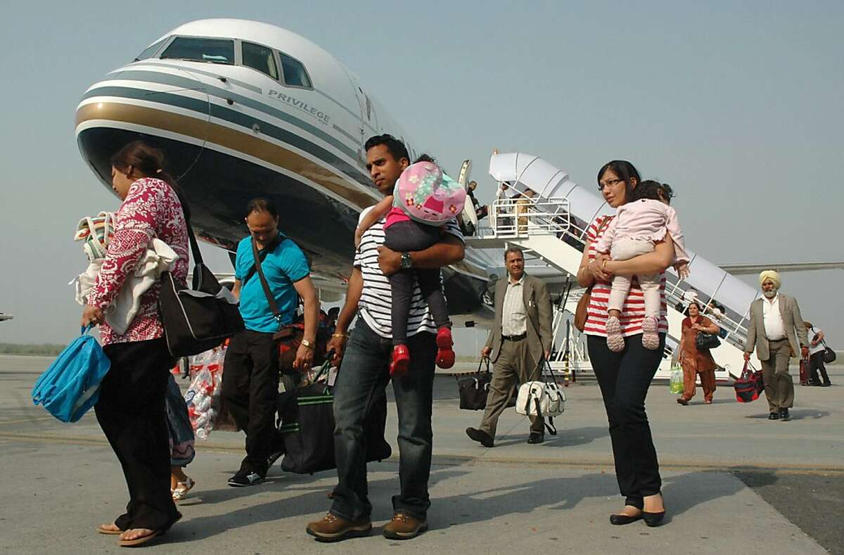 In this photograph taken on October 2, 2011 Indian passengers arrive from Austria at the Rajasansai International Airport on a Comtel Air flight in Amritsar. Comtel passengers travelling from Amritsar to Birmingham via Vienna, most of them of Indian-origin, had to pay GBP 20,000 (USD 31,541) on November 13, when the airline could not afford to meet the fuel and other costs of the second leg of the journey. Authorities are seeking reassurances from Comtel after passengers claimed they were forced to fund the remainder of their trip back to Britain. AFP PHOTO/ NARINDER NANU (Photo credit should read NARINDER NANU/AFP/Getty Images) (FILES) In this photograph taken on October 2, 2011 Indian passengers arrive from Austria at the Rajasansai International Airport on a Comtel Air flight in Amritsar. Comtel passengers travelling from Amritsar to Birmingham via Vienna, most of them of Indian-origin, had to pay GBP 20,000 (USD 31,541) on November 13, when the airline could not afford to meet the fuel and other costs of the second leg of the journey. Authorities are seeking reassurances from Comtel after passengers claimed they were forced to fund the remainder of their trip back to Britain. AFP PHOTO/ NARINDER NANU (Photo credit should read NARINDER NANU/AFP/Getty Images)