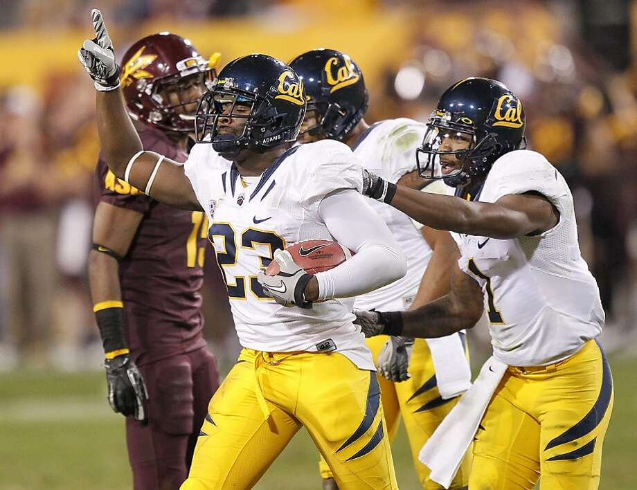 California defensive back Josh Hill (23) celebrates his interception with teammate Steve Williams (1) against Arizona State during the second half of an NCAA college football game Saturday, Nov. 26, 2011, in Temp, Ariz. (AP Photo/Matt York) Photo: Matt York, ASSOCIATED PRESS