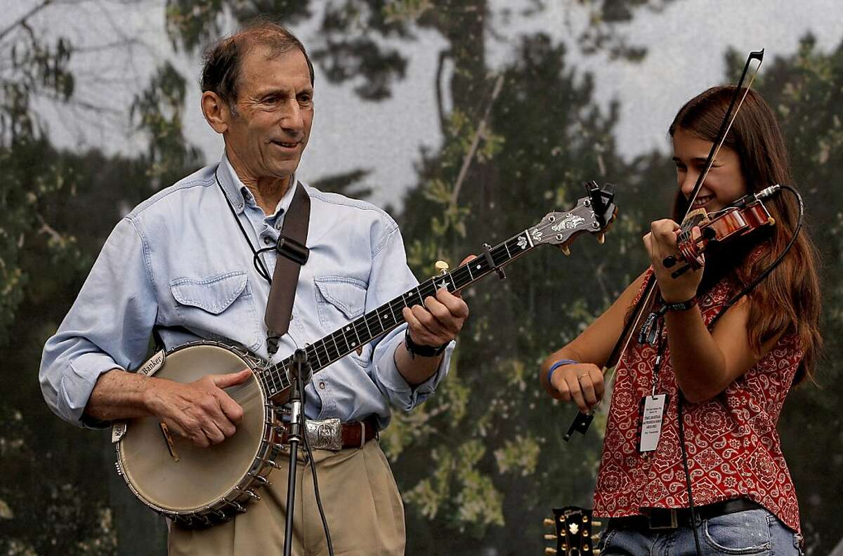 Hardly Strictly Bluegrass Festival sponsor, Warren Hellman joins 13 year old Ruby Jane as they play a bluegrass tune to open the festival in San Francisco, Calif. on Friday Oct. 3, 2008, entertaining kids from local schools. Ruby Jane is the featured artist chosen by the Daniel Pearl foundation to open the bluegrass festival. Ran on: 10-05-2008 Mike Nelson (center) and others dance to the music of the Peter Rowan Bluegrass Band at the Hardly Strictly Bluegrass Festival. Ran on: 09-25-2009 Warren Hellman performs at the bluegrass fest he started. Ran on: 09-25-2009 Warren Hellman performs at the bluegrass fest he started. Ran on: 01-02-2010 Warren Hellman, left, joins Ruby Jane, 13, in a tune at 2009s Hardly Strictly Bluegrass Festival, where fans dance in 2008, above.