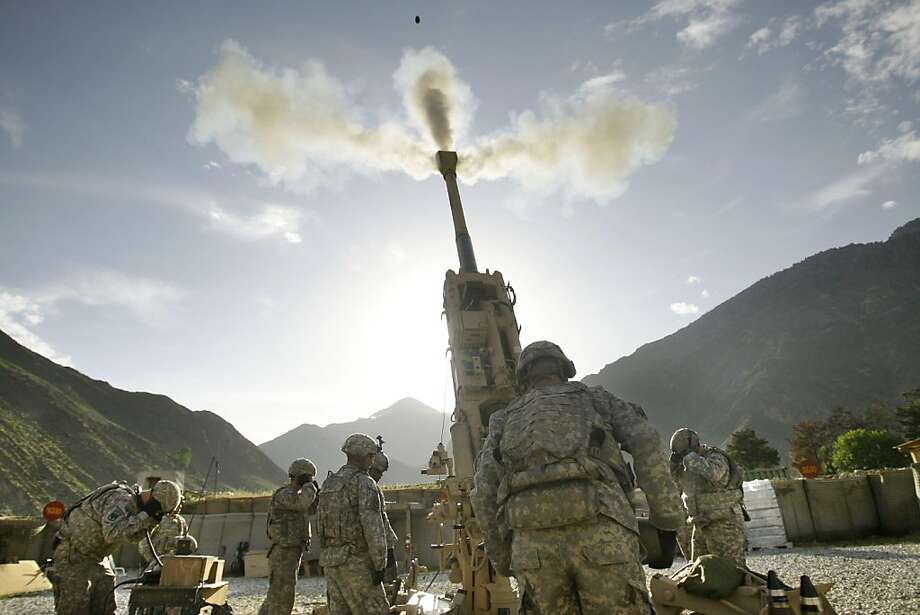 U.S. soldiers test fire artillery from a position inside the U.S. base camp Blessing in Afghanistan's Kunar Province Wednesday, May 6, 2009.  (AP Photo/David Guttenfelder)  Ran on: 12-19-2011 U.S. troops test-fire artillery at Camp Blessing in Afghanistan in 2009. A U.S. Army captain developed an iPhone app to guide artillery fire to save lives. Photo: David Guttenfelder, AP