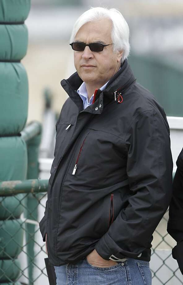Trainer Bob Baffert watches his Preakness entrant Lookin At Lucky during morning workouts at Pimlico Race Course, Thursday, May 13, 2010, in Baltimore. The 135th Preakness Stakes horse race is Saturday, May 15. (AP Photo/Rob Carr)  Ran on: 05-14-2010 Trainer Bob Baffert has won the Preakness Stakes four times. Photo: Rob Carr, AP