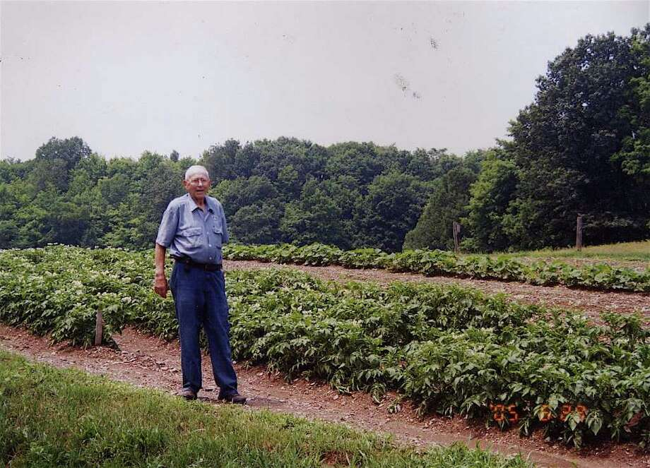 The late Sanford Bonesteel, a longtime famer in Brunswick, stands next to one of his cornfields in 2005. His former farm, later rezoned by the town to make way for a housing development, is on a new list of potential protected wetlands issued by the state Department of Environmental Conservation.