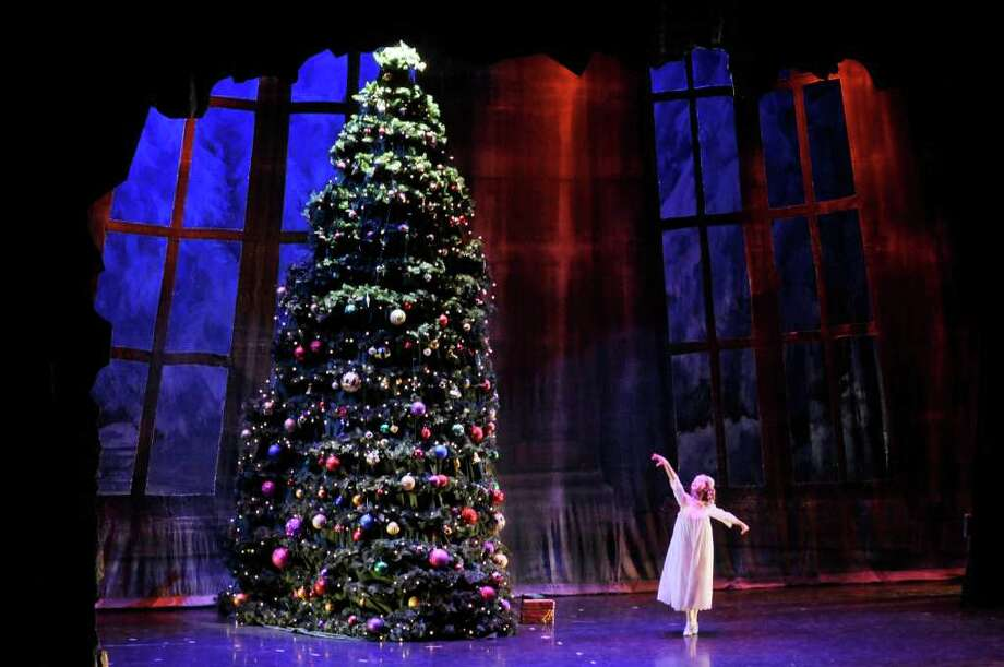 Lily Pickett, who plays the part of Clara, dances as the Christmas tree grows much larger in her dreams during the Albany Berkshire Ballet performance of The Nutcracker at The Egg on Sunday, Dec. 18, 2011 in Albany, N.Y.  The ballet company performed two shows at The Egg on Sunday, which were the final shows for this year's Nutcracker which began in November.  The Albany Berkshire Ballet traveled to Great Barrington, Mass., Burlington, Vt., Andover, Mass., Pittsfield, Mass., and Springfield, Mass., along with Albany to perform the ballet this year. (Paul Buckowski / Times Union) Photo: Paul Buckowski