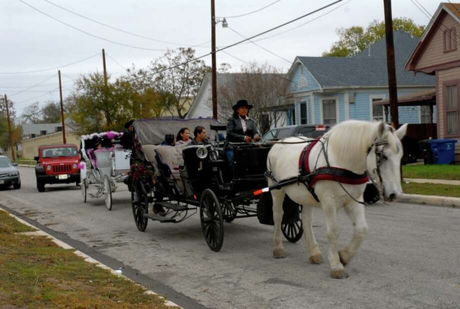A horse-drawn ride through the historic streets of Government Hill carries passengers during the 15th annual Christmas on the Hill Tour of Homes Dec. 11. Photo: Photo By Jason P. Olivarri