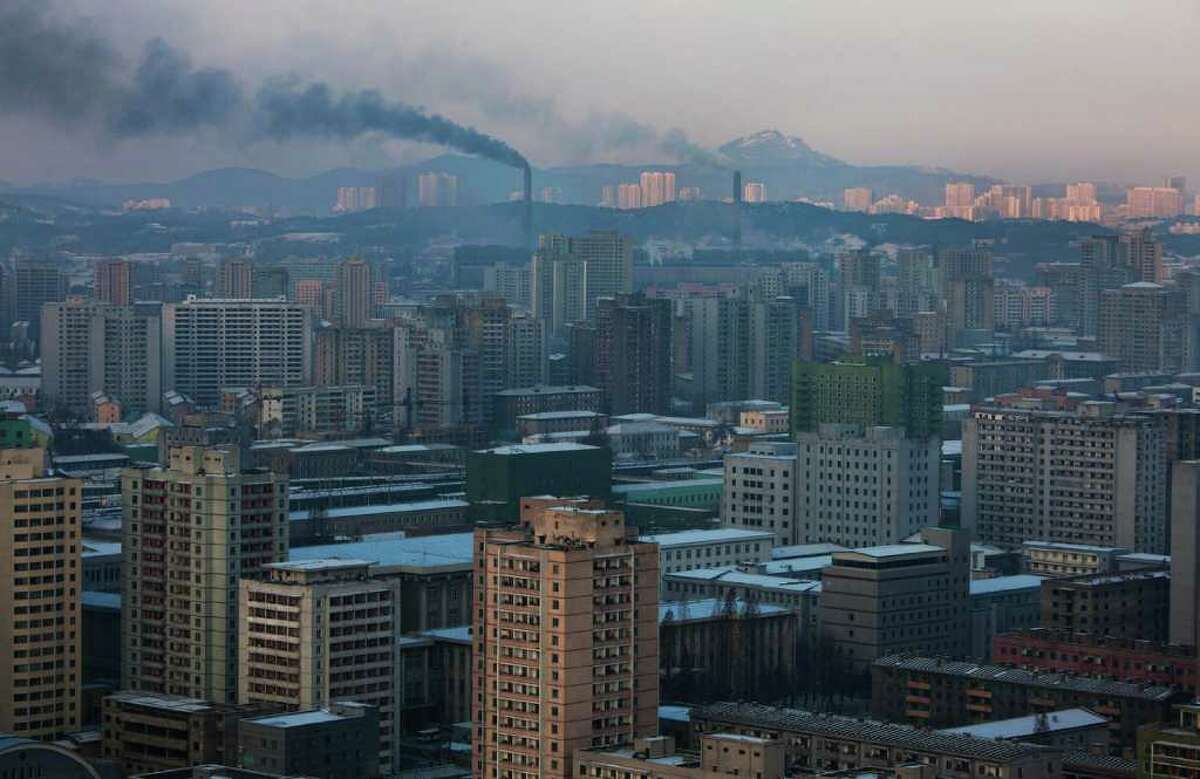 In this Friday Dec. 9, 2011 photo, smoke rises from factories over central Pyongyang, North Korea.