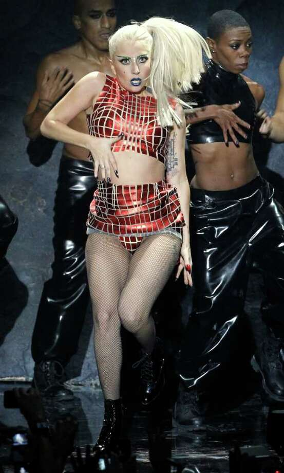 FILE - In this Nov. 6, 2011 file photo, Lady Gaga performs at the MTV European Music Awards 2011, in Belfast, Northern Ireland. Lady Gaga has been voted the Associated Press Entertainer of the Year. The determination was made by ballot by editors and broadcasters from U.S. news organizations that make up the AP's membership. (AP Photo/Joel Ryan, file) Photo: Joel Ryan / AP2011