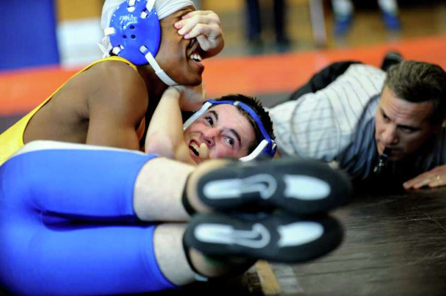 Fairfield Ludlowe's Austin Reid wrestles Harding's Jevaun James in the 132 lb. weight class Saturday, Dec. 17, 2011 during Fairfield Ludlowe High School's Invitational wrestling match. Photo: Autumn Driscoll / Connecticut Post