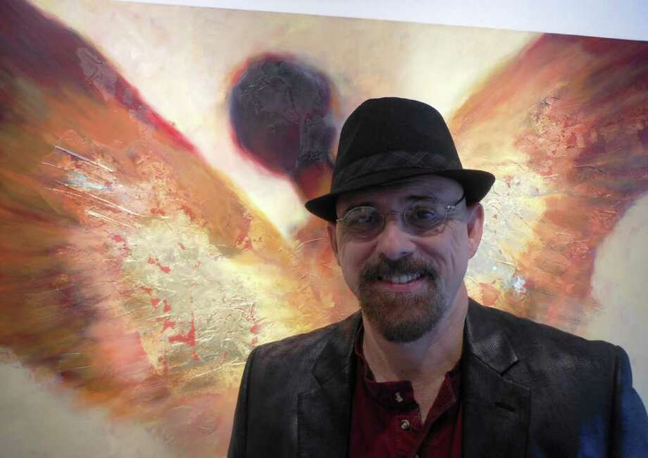 "San Antonio artist Steven DaLuz is showing a series of angel paintings in an exhibition titled ""Watchers"" at AnArte Gallery. Photo: Steve Bennett, Sbennett@express-news.net"