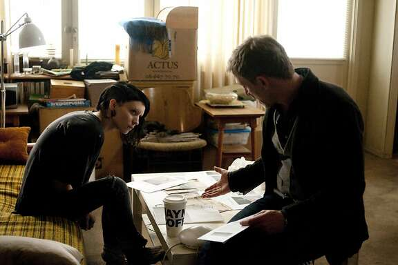 """Rooney Mara, left, and Daniel Craig star in Columbia Pictures' """"The Girl with the Dragon Tattoo."""" (Merrick Morton/Courtesy Columbia Pictures/MCT)"""