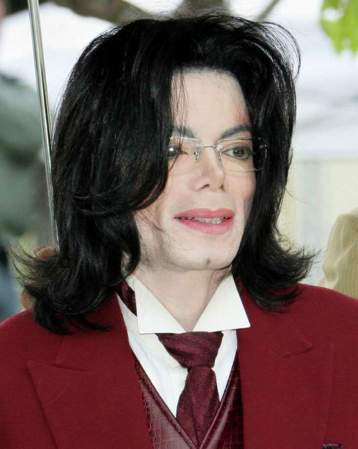 FILE - In this April 27, 2005 file photo, Michael Jackson arrives at the Santa Barbara County courthouse in Santa Maria, Calif. A judge on Monday, Dec. 19, 2011, approved a request by the two men running the late pop star's estate to receive additional compensation for their professional services. (AP Photo/Michael Mariant, File) Photo: Michael A Mariant
