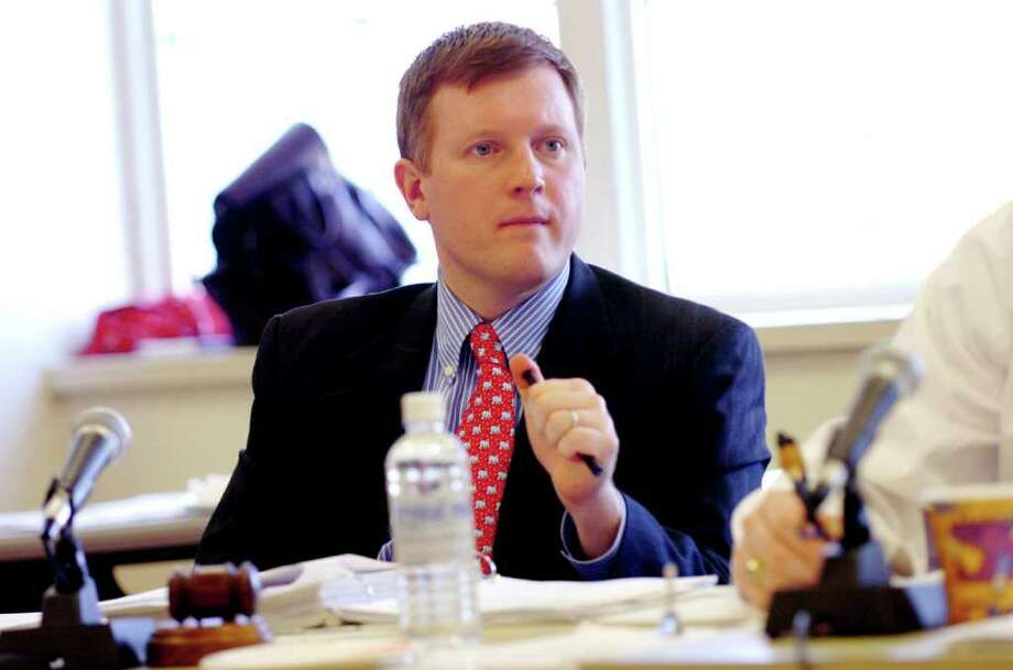 In this February 2007 file photo, Board of Estimate and Taxation Chairman Stephen Walko and town finance officials vote on funding for a rebuilt Glenville School. (Staff Photo Helen Neafsey) Photo: File Photo, ST / Greenwich Time File Photo