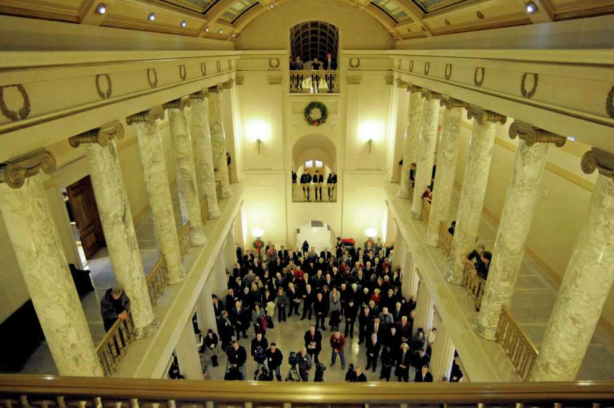 People gather in the rotunda during a re-dedication ceremony at the Albany County Courthouse on Monday, Dec. 19, 2011 in Albany, NY. The courthouse was originally dedicated in 1916. The six-year renovation and restoration project also included updating the building with state of the art technology. (Paul Buckowski / Times Union)