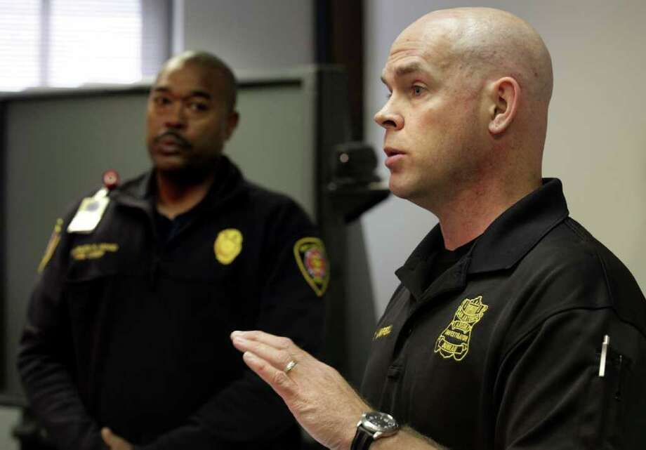 Fire Department Chief Charles N. Hood, left, and Arson Lt. Ken Campbell announce that the San Antonio Fire Department Arson Bureau has ruled the fire at 4700 Stringfellow back on August 16th, 2011, to be caused by arson. Photo: BOB OWEN, SAN ANTONIO EXPRESS-NEWS / rowen@express-news.net