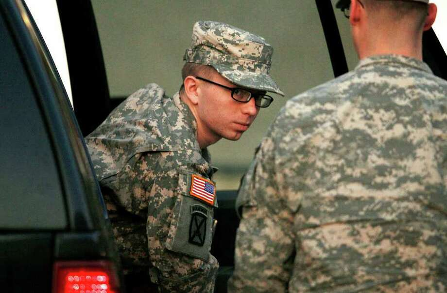 Army Pfc. Bradley Manning is escorted from a security vehicle to a courthouse in Fort Meade, Md., Monday, Dec. 19, 2011, for a military hearing that will determine if he should face court-martial for his alleged role in the WikiLeaks classified leaks case. Photo: AP