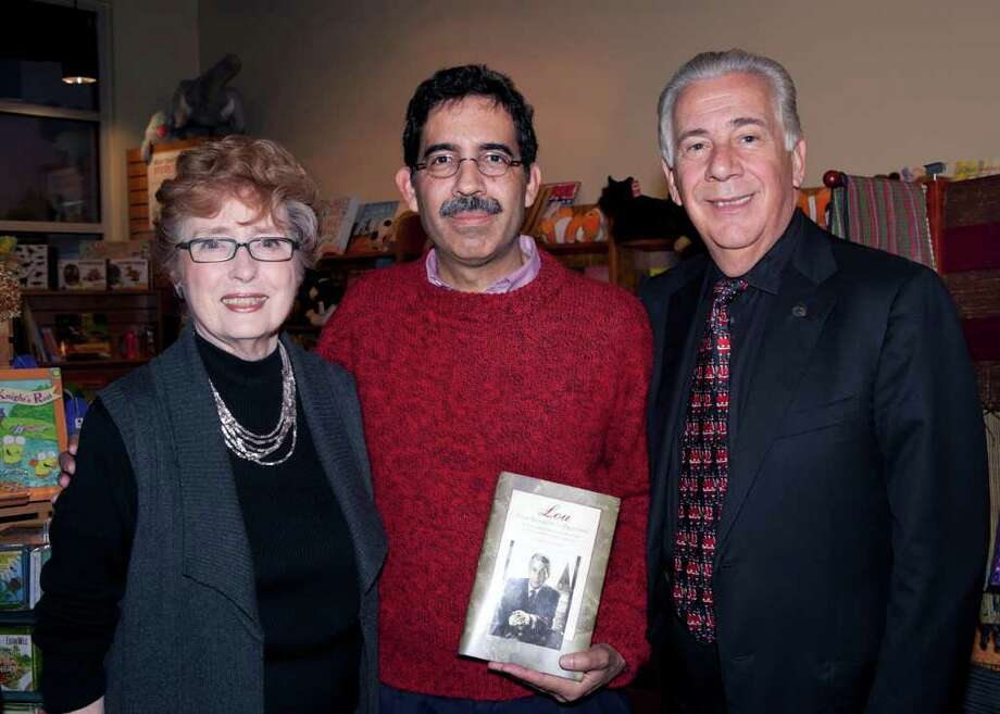 """OTS/TRENDS/HEIDBRINK  Author Patricia Watkins, from left, Vincent Rodriguez and Louis Agnese, Jr.,  get together at a book signing for """"Lou: From Brooklyn to Broadway, the UIW's 25 years with Dr. Louis J. Agnese, Jr.,"""" at the Twig at the Pearl Brewery. Photo by Jamie Karutz. Photo: Jamie Karutz, For The Express-News / Special to the Express-News"""