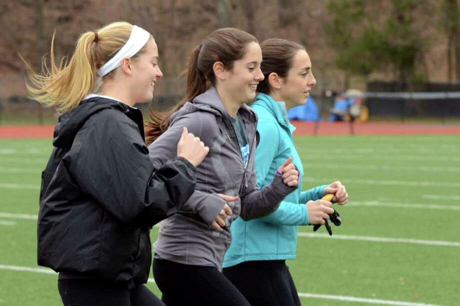 Greenwich's Jenny Goggin, Abby Markowitz, and Elizabeth Markowitz warm up during girls track practice at Greenwich High School on Monday, Dec. 19, 2011. Photo: Amy Mortensen / Connecticut Post Freelance