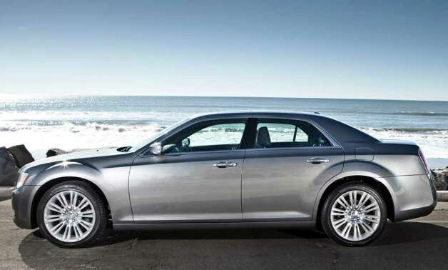 Up to five people can ride comfortably in the 2012 Chrysler 300 sedan, which comes with a choice of either a 292-horsepower V-6 or two V-8 engines. Photo: Chrysler Group LLC.