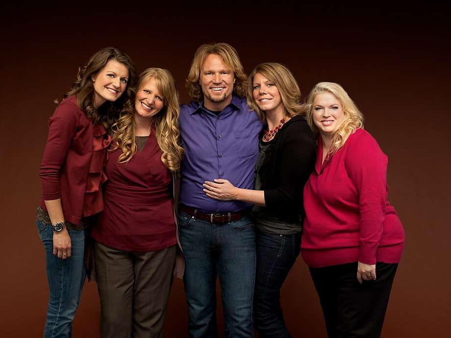 "FILE - In this publicity file image provided by TLC, Kody Brown, center, poses with his wives, from left,  Robyn, Christine, Meri and Janelle in a promotional photo for the reality series, ""Sister Wives."" The polygamous family made famous on the TLC show  is asking a U.S. judge not to block their challenge of Utah's bigamy law. Kody Brown and wives Meri, Janelle, Christine and Robyn filed a lawsuit in Salt Lake City's U.S. District Court in July 2011. The stars say the law is unconstitutional because it prohibits them from living together and criminalizes their private sexual relationships.  (AP Photo/TLC, George Lange, File) Photo: George Lange, Associated Press"