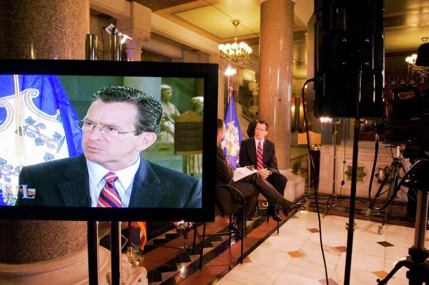Gov. Dan Malloy serves as the guest on a cablevision television program being taped in the state Capitol in Hartford, Conn. on October 27, 2011. The governor made it a point to engage with the press.