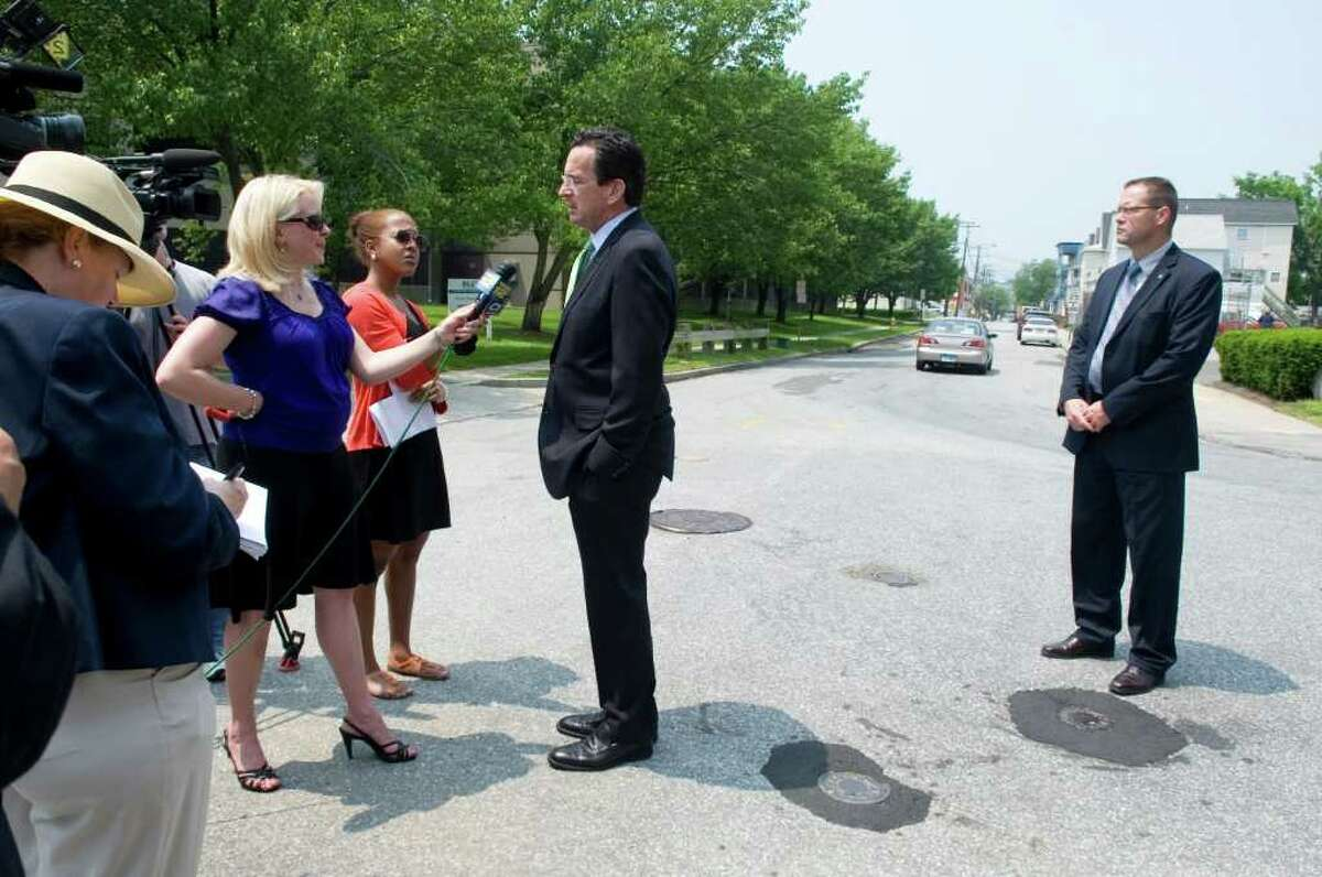 Gov. Dan Malloy takes questions from the media at a 'street renaming' ceremony marking Starwood Hotels and Resorts move into 333 Ludlow Street in Stamford, Conn. on Wednesday June 1, 2011. Ludlow Street will now be One StarPoint.