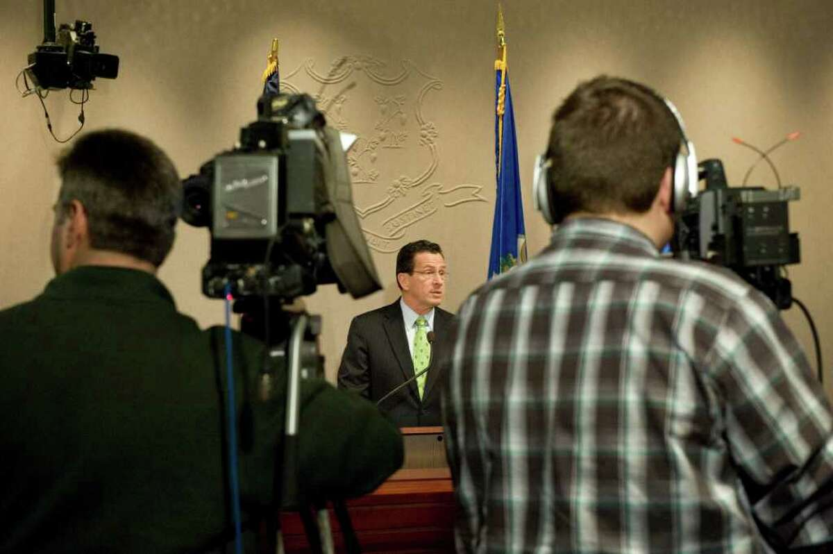 Gov. Dan Malloy announces his budget revisions at a press conference at the Legislative Office Building in Hartford, Conn. on Thursday April 14, 2011.