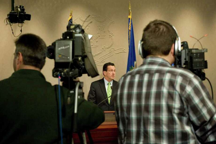 Gov. Dan Malloy announces his budget revisions at a press conference at the Legislative Office Building in Hartford, Conn. on Thursday April 14, 2011. Photo: Kathleen O'Rourke / Stamford Advocate