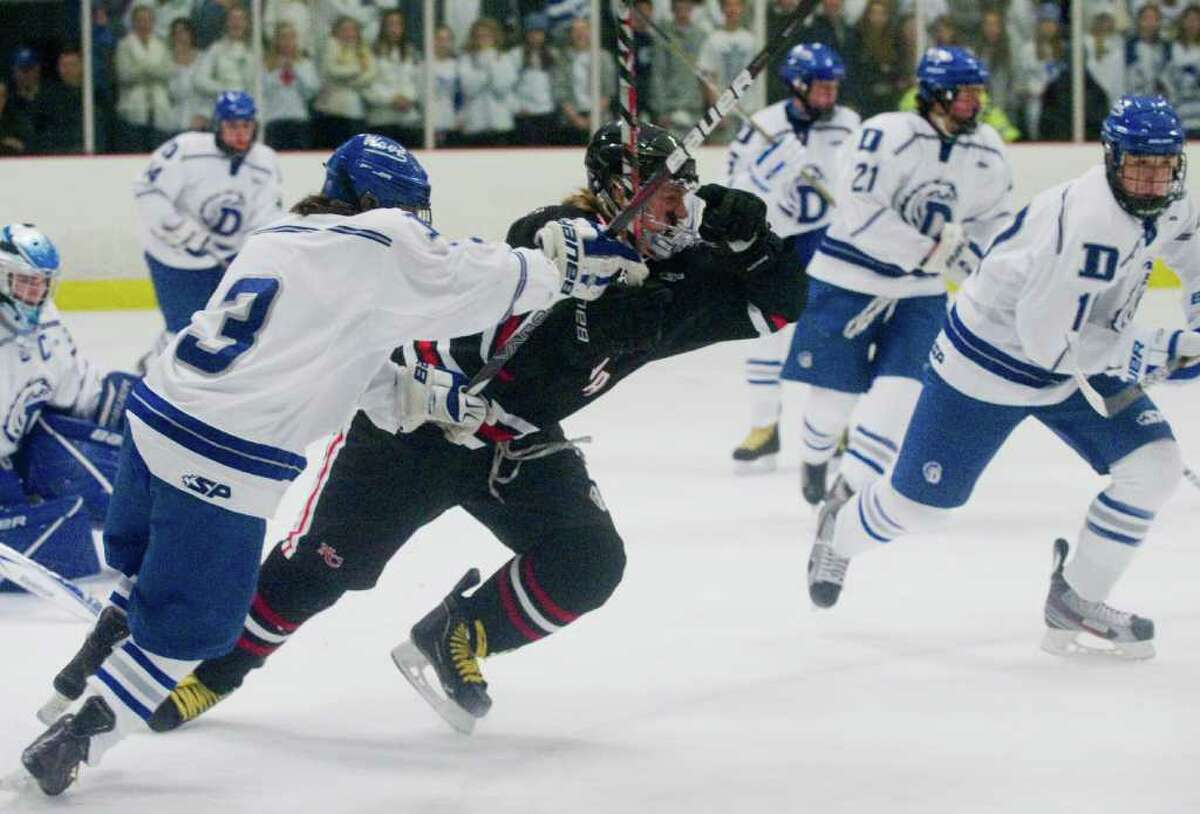 Darien High School hosts New Canaan in a boys hockey game at the Darien Ice Rink in Daien, Conn., December 19, 2011.