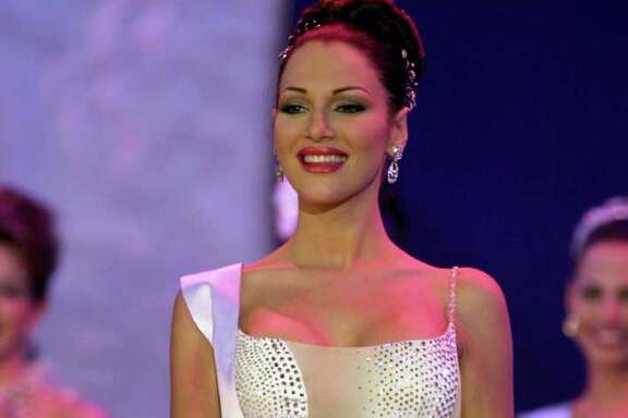 FILE - In this photo taken on Sept. 9, 2000, Eva Ekvall competes in the Miss Venezuela 2000 beauty contest in Caracas, Venezuela.  Ekvall, whose struggle with breast cancer was closely followed by Venezuelans, has died at age 28. Her family said Ekvall died Saturday Dec. 17 at a hospital in Houston.  Ekvall was crowned Miss Venezuela in 2000, and the following year she was third runner-up in the Miss Universe pageant in Puerto Rico. She went on to work as a model, actress and television news anchor. (AP Photo/Fernando Llano)