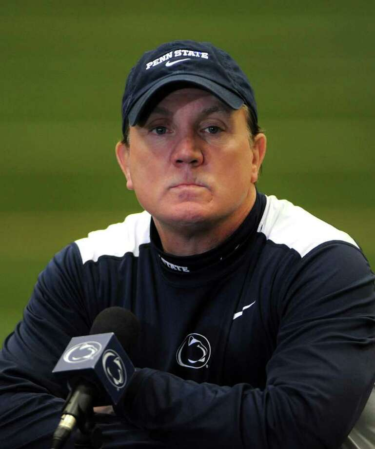Penn State football interim head coach Tom Bradley grimaces during a news conference in State College, Pa., Monday, Dec. 19, 2011.   Bradley interviewed to keep the job on a permanent basis but doesn't know when the school might reach a decision. (AP Photo/Center Daily Times, Nabil K. Mark)  NO SALES. MANDATORY CREDIT. MAGS OUT. Photo: Nabil K. Mark