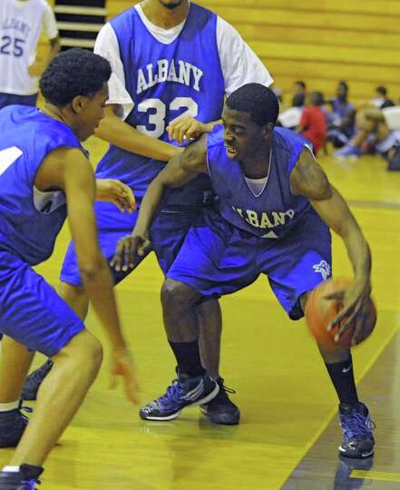 Albany High School basketball player Daquan Johnson, right,  practices with the team Monday, Dec. 19