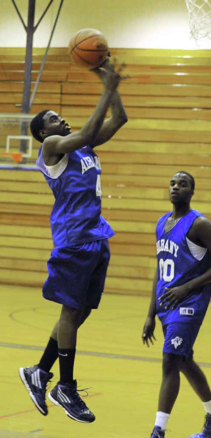 Albany High School basketball player Daquan Johnson shoots the ball during practice with the team Monday, Dec. 19, 2011 in Albany, N.Y. (Lori Van Buren / Times Union)