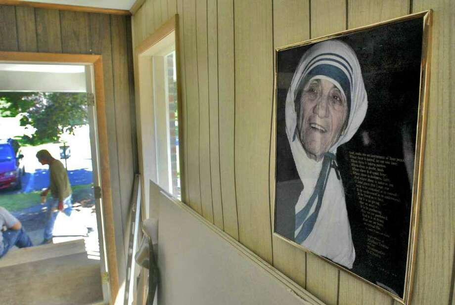 Times Union Staff photograph by Philip Kamrass -- A picture of Mother Teresa hangs in the entrance of  the new Mother Teresa Academy in Clifton Park, NY Monday September 8, 2008. The school just got its building permit from the town of Clifton Park. School officials estimate that it will take about 10 days to prepare the school. The school's students are currently meeting at the home of the principal.FOR CHRISTEN DEMING STORY. Photo: PHILIP KAMRASS PHILIP KAMRASS / 00000191A