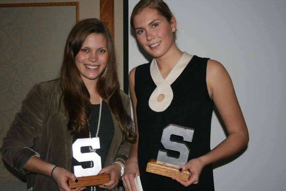 Staples girls volleyball senior captains Kenzie Roof, left, and Joosje Grevers celebrate their Block S Coach's award and Block S Team MVP award, respectively. Photo: Contributed Photo