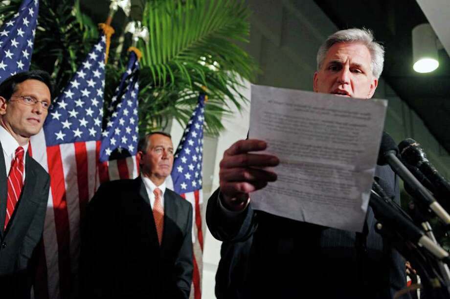 WASHINGTON, DC - DECEMBER 19:  Rep. Kevin McCarthy (R-CA) reads a list of quotes by Senate Democrats during a brief news conference with Speaker of the House John Boehner (R-OH) (C) and Majority Leader Eric Cantor (R-VA) (L) after a House GOP caucus meeting at the U.S. Capitol December 19, 2011 in Washington, DC. Boehner said he expects the House to reject a short-term plan to extend the tax cuts for another two months that passe the Senate last week.  (Photo by Chip Somodevilla/Getty Images) Photo: Chip Somodevilla