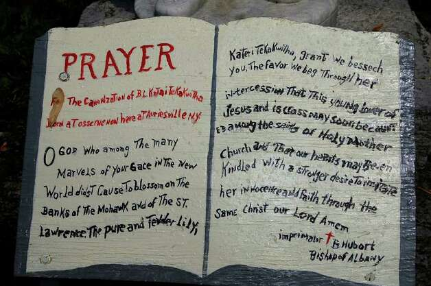 A prayer at the base of the statue of Blessed Kateri Tekakwitha is shown at the Shrine of Our Lady of Martyrs in Auriesville in this 2004 archive photo. Blessed Kateri, the Lady of the Mohawks, was among seven new saints approved Monday, Dec. 19, 2011, by Pope Benedict XVI. (Times Union archive) Photo: LUANNE M. FERRIS / ALBANY TIMES UNION