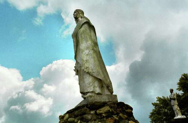 A statue of Blessed Kateri Tekakwitha is shown on the grounds of theShrine of Our Lady of Martyrs in Auriesville in this 2000 archive photo.  The Lady of the Mohawks was among seven new saints approved Monday, Dec. 19, 2011, by Pope Benedict XVI. (Times Union archive) Photo: MICHAEL P. FARRELL / ALBANY TIMES UNION