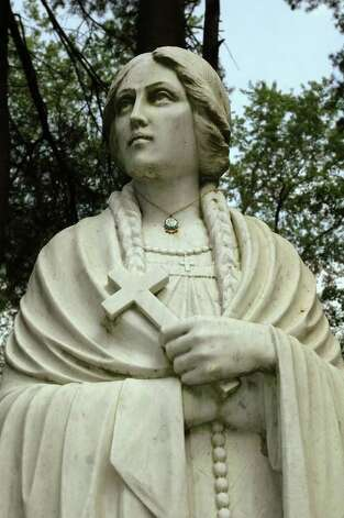 A statue of Blessed Kateri Tekakwitha is shown on the grounds of theShrine of Our Lady of Martyrs in Auriesville in this 2004 archive photo.  The Lady of the Mohawks was among seven new saints approved Monday, Dec. 19, 2011, by Pope Benedict XVI. (Times Union archive) Photo: LUANNE M. FERRIS / ALBANY TIMES UNION