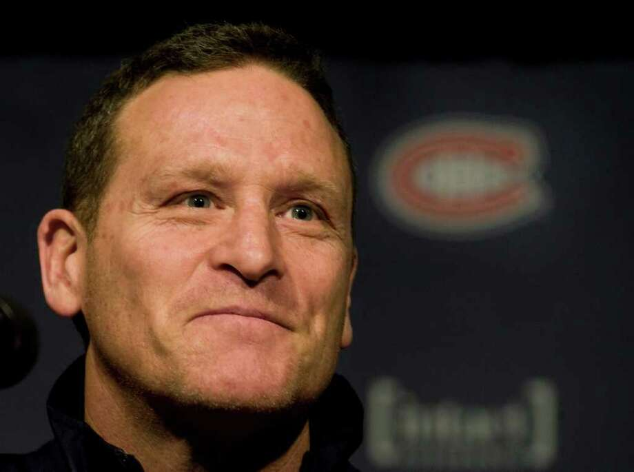 This Dec. 17, 2011 photo shows Randy Cunneyworth speaking at a news conference in Montreal after being named as interim head coach of the Montreal Canadiens.  The Quebec government isn't pleased about the hiring of a Montreal Canadiens coach who can't speak French.  The province's culture minister says she expects the Habs to correct the situation. (AP Photo/The Canadian Press, Graham Hughes) Photo: Graham Hughes / CP