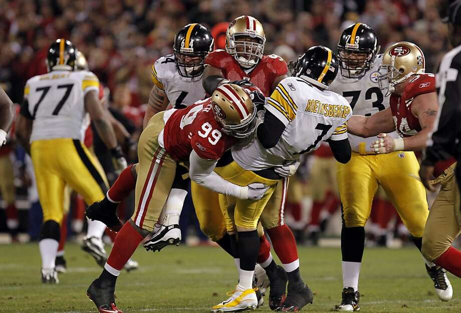 Aldon Smith gets one of his 2.5 sacks on Pittsburgh's Ben Roethlisberger, who threw three interceptions and lost a fumble. Photo: Michael Macor, The Chronicle
