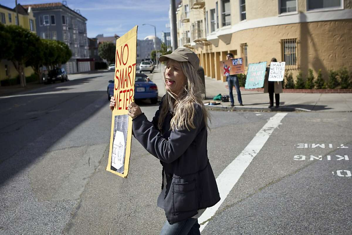Sudi Scull walks through the Marina District protesting the installation of PG&E's SmartMeters in San Francisco, Calif., on Tuesday, March 1, 2011. Scull says she suffered health effects when SmartMeters were installed in her home.