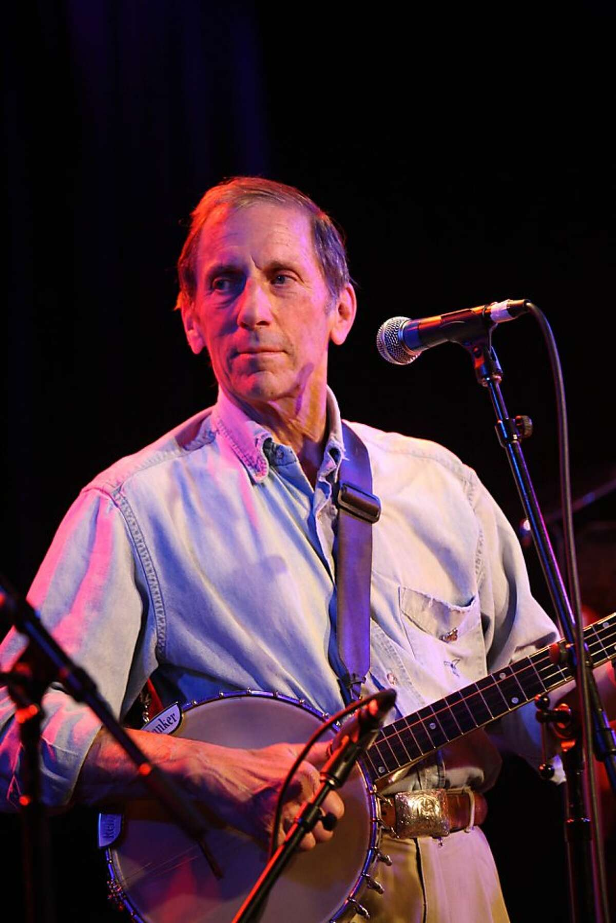 Warren Hellman, one of Slims partners, performs with the Wronglers during the gathering at a private party held to celebrate the 20th anniversary of Slims on Tuesday, October 14, 2008 in San Francisco, Calif.
