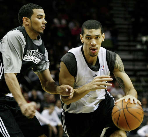 The Silver's Danny Green (right) drives around the Black's Cory Joseph during the team's Silver and Black scrimmage on Monday, Dec. 19, 2011 at the AT&T Center. The Silver team, comprised of Spurs backups, beat the Black team of starters 83-75. Photo: Darren Abate, For The Express-News