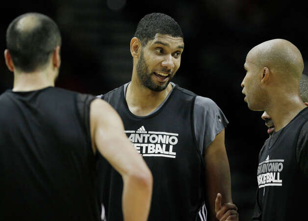 Spurs players Tim Duncan (center) talks to teammates Manu Ginobili (left) and Richard Jefferson as their Black team takes on the Silver team in an intrasquad scrimmage on Monday, Dec. 19, 2011 at the AT&T Center. The Silver team, comprised of Spurs backups, beat the Black team of starters 83-75. Photo: Darren Abate, For The Express-News