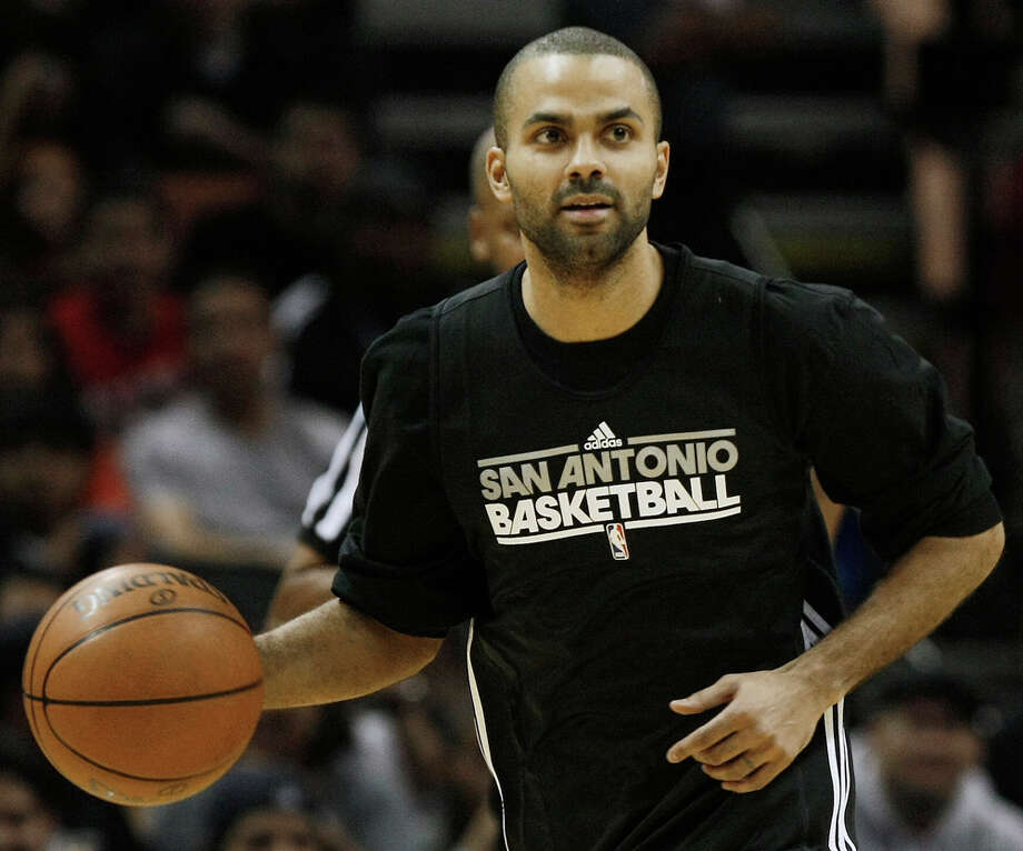 Spurs guard Tony Parker plays for the Black during an intrasquad scrimmage on Monday, Dec. 19, 2011 at the AT&T Center. The Silver team, comprised of Spurs backups, beat the Black team of starters 83-75. Photo: Darren Abate, For The Express-News