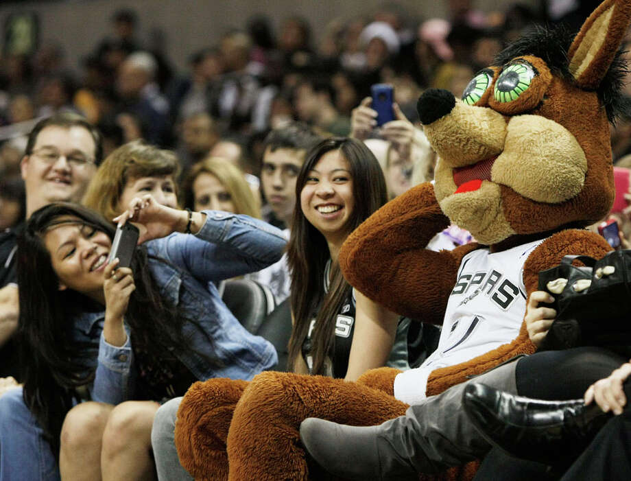 The Spurs Coyote jokes around with fans during the team's Silver and Black scrimmage on Monday, Dec. 19, 2011 at the AT&T Center. Photo: Darren Abate, For The Express-News