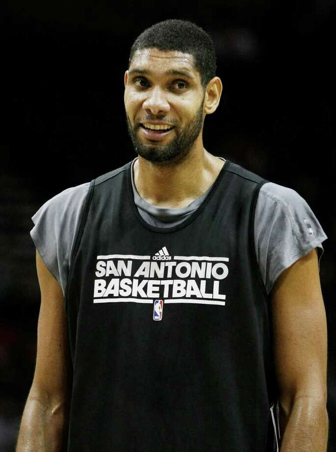 Spurs center Tim Duncan, playing for the Black, pauses on the court during the team's Silver and Black intrasquad scrimmage on Monday, Dec. 19, 2011 at the AT&T Center. The Silver team, comprised of Spurs backups, beat the Black team of starters 83-75. Photo: Darren Abate, For The Express-News