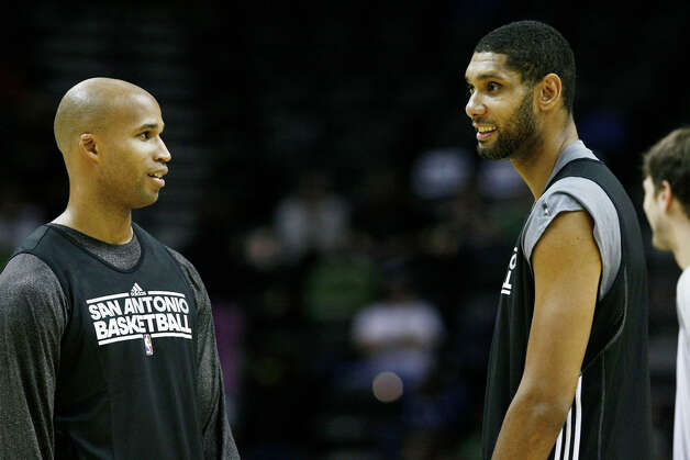 Spurs players Richard Jefferson (left) and Tim Duncan talk during the team's intrasquad scrimmage on Monday, Dec. 19, 2011 at the AT&T Center. Photo: Darren Abate, For The Express-News