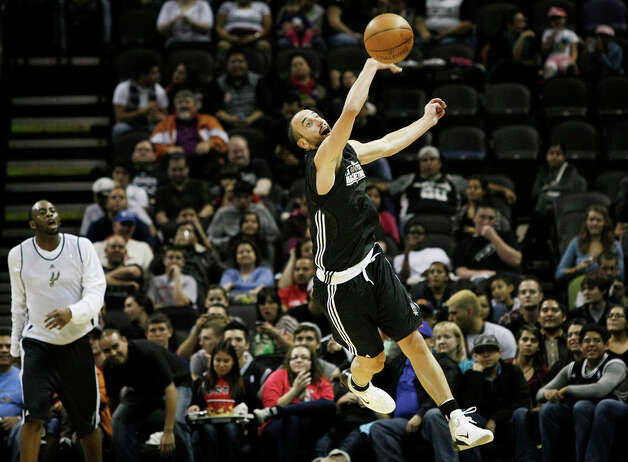 The Spurs' Manu Ginobili swats a pass out of the air for the Black during the team's Silver ad Black intrasquad scrimmage on Monday, Dec. 19, 2011 at the AT&T Center. The Silver team, comprised of Spurs backups, beat the Black team of starters 83-75. Photo: Darren Abate, For The Express-News