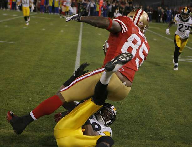 49er Vernon Davis is tackled by Cortez Allen after making a first down during the San Francisco 49ers vs. the Pittsburg Steelers at Candlestick Park in San Francisco, Calif., on Monday, December 19, 2011. Photo: John Storey, Special To The Chronicle